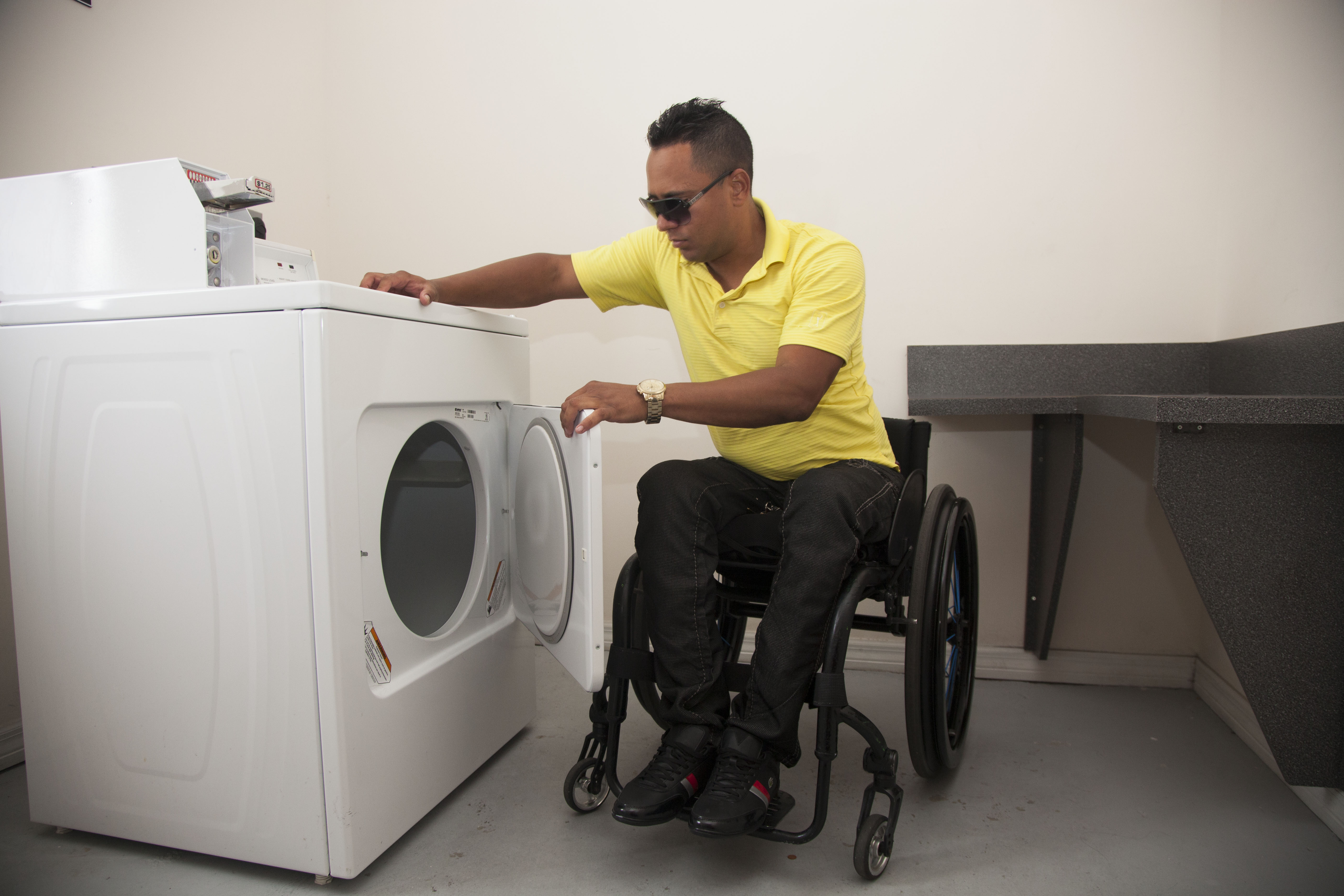 SCLAD Plaza Residents enjoy a fully accessible laundry unity